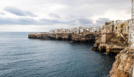 Panoramic city skyline with white houses of Polignano a Mare, town on the rocks, Italian town of the metropolitan city of Bari in Puglia region, Italy. Banco de Imagens