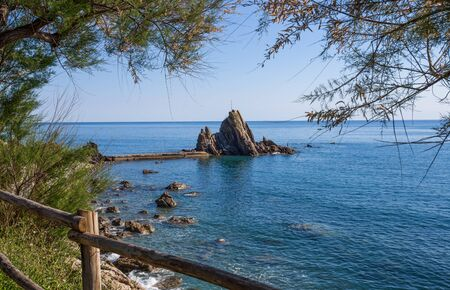 View of the rock with the cross in the village of Riva Trigoso, ligurian riviera, Genoa province, Italy