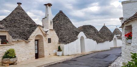 Beautiful town of Alberobello with trulli houses. It is an Italian town in the metropolitan city of Bari, in Puglia,  Italy Banco de Imagens