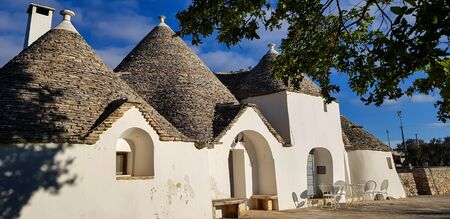 Beautiful town of Alberobello with trulli houses. It is an Italian town in the metropolitan city of Bari, in Puglia,  Italy Stock Photo