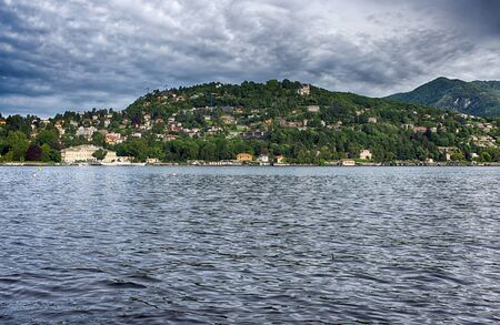 View of Como lake in a cloudy day, Italy Stock Photo
