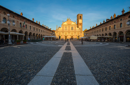 VIGEVANO, ITALY, MAY 10, 2015 - View of Ducale square with Ambrogio church in Vigevano, Pavia province, Italy