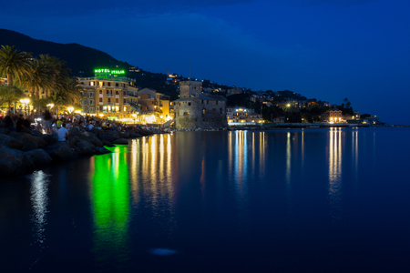 RAPALLO, ITALY JULY, 3, 2019 - View of Rapallo, Genoa (Genova) province and the castle on the sea by night, Italy.