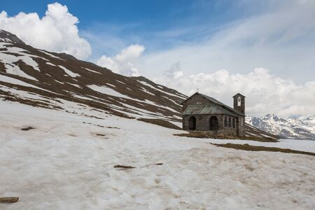 Old stone church at Gavia pass, an alpine pass of the Southern Rhaetian Alps, marking the administrative border between the provinces of Sondrio and Brescia, Italy.