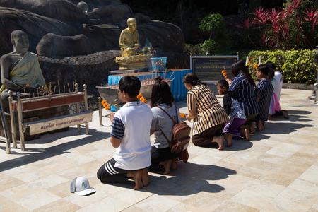SAKON NAKHON, THAILAND FEBRUARY 2, 2019 - Buddhist faithful pray in Tham Pha Daen Wat temple, Sakon Nakhon, Thailand