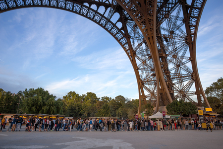 PARIS, FRANCE, SEPTEMBER 8, 2018 - People waiting in long queue at Eiffel Tower in Paris, France Editorial