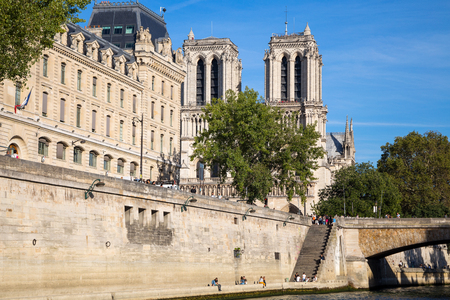 PARIS, FRANCE, SEPTEMBER 8, 2018 - Notre Dame of Paris Chatedral in Paris from Seine river in Paris, France