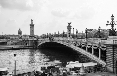 PARIS, FRANCE, SEPTEMBER 5, 2018 - View of Alexander III Bridge over the River Seine, with the Hotel des Invalides on the background in Paris, France Editorial