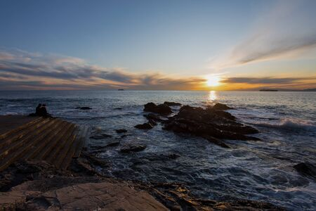 Sunset with the rough sea in autumntime, Italy Standard-Bild - 134071362