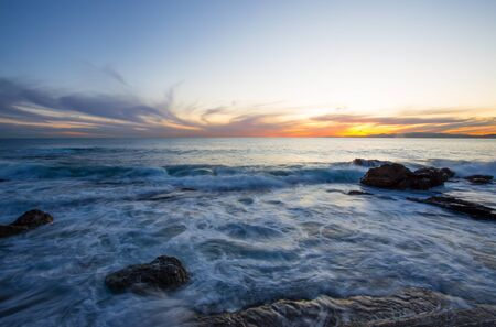 Sunset with the rough sea in autumntime, Italy Standard-Bild