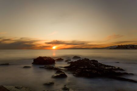 Long exposure of a sunset with the rough sea in autumntime, Italy Standard-Bild - 134071355