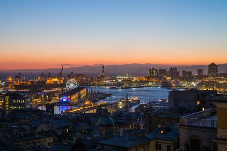 GENOA, ITALY, NOVEMBER  5, 2019 - Aerial view of Genoa, Italy at dusk, the harbor with the hiistoric centre, Italy, Europe Editorial