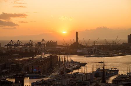 GENOA, ITALY, NOVEMBER  5, 2019 - Aerial view of Genoa, Italy at sunset, the harbor with the Lanterna, the lighthouse,  symbol of the city,  Italy.