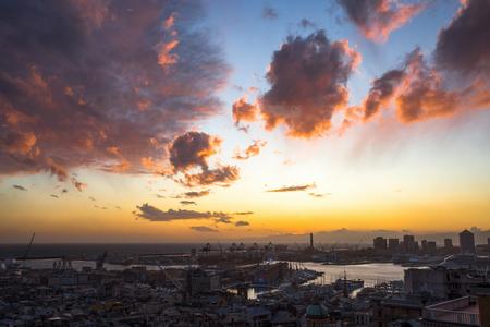 GENOA, ITALY, NOVEMBER  5, 2019 - Aerial view of Genoa, Italy at sunset, the harbor with the hiistoric centre, Italy, Europe Standard-Bild - 134057827
