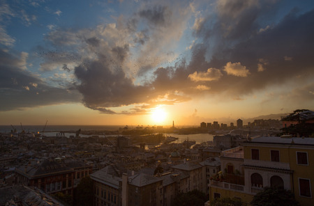 GENOA, ITALY, NOVEMBER  5, 2019 - Aerial view of Genoa, Italy at sunset, the harbor with the hiistoric centre, Italy, Europe