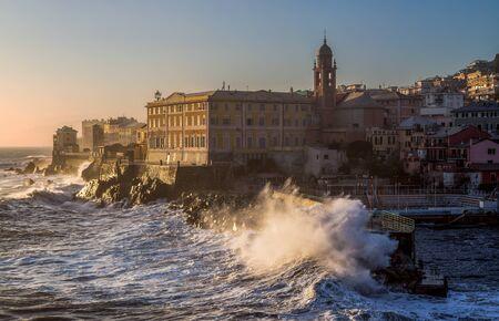 GENOA, ITALY, FEBRUARY 7, 2020  - Big stormy waves crashing over the pier, Genoa (Genova) Nervi, Italy.