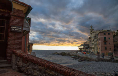 GENOA, ITALY, FEBRUARY 7, 2020 - View of Genova Boccadasse under a cloudy sky at sunset, Italy.
