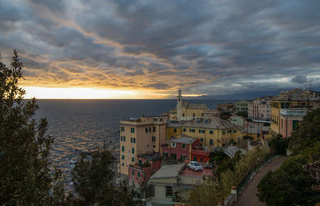GENOA, ITALY, FEBRUARY 7, 2020 - View of Genova Boccadasse under a cloudy sky at sunset, Italy. Standard-Bild - 141908021