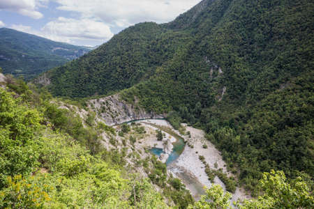 The river Trebbia and the surrounding hills during the summer, Emilia Romagna, Piacenza province, Italy.