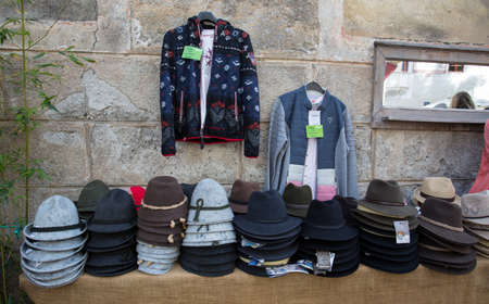 GLORENZA, ITALY, SEPTEMBER 11, 2020 - Typical South Tyrolean hats and clothing on sale in Glorenza, province of Bolzano, South Tyrol, Italy Editorial