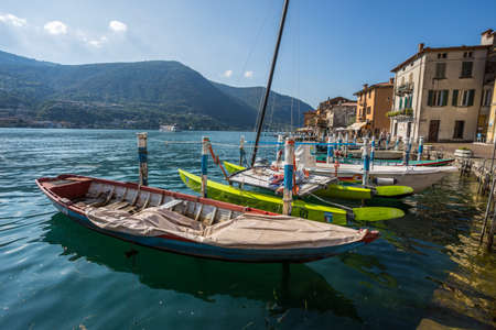 MONTE ISOLA, ITALY, SEPTEMBER 9, 2020 - Boats moored at Monte Isola, Iseo Lake, Brescia province, Lombardy, Italy.
