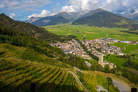 Aerial view of the historic center of Burgusio, Malles, and the Prince's Castle, Val Venosta, South Tyrol, Italy