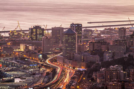 GENOA, ITALY, NOVEMBER 18,2020 - Aerial view of Genoa at dusk, modern buildings, the harbor and the causeway, Italy Editorial