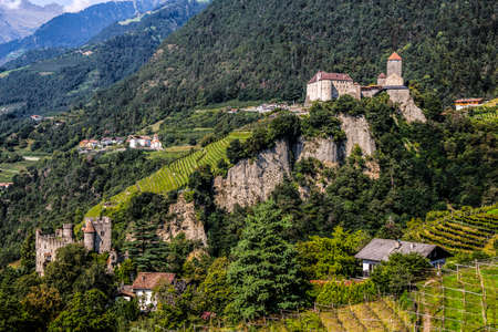 The Brunnenburg castle and Tyrol Castle near Merano, South Tyrol in the town of Tirolo, Bolzano province, Italy.