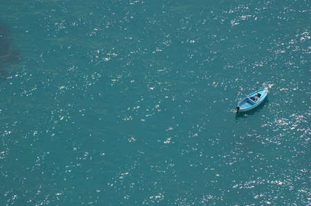 Wood boat in the blue sea photo