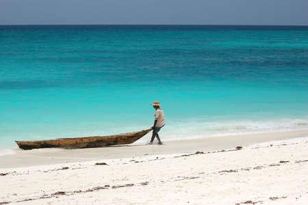 Fisherman on the beach in Zanzibar, Tanzania Stock Photo