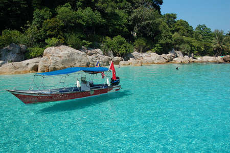 Boat on the blue sea - Perhentian, Malaysia
