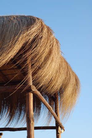 straw hut - summer time photo
