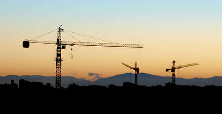 Building under construction - silhouette in the orange sunset photo