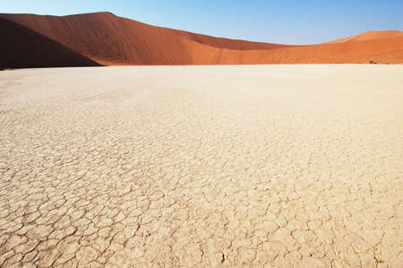 lack of water: Dry terrain and dune - Lack of water. Namibia, Deadvlei, Sossuvlei. Stock Photo
