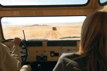 Woman and driver in the desert - Safari photo
