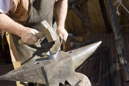 blacksmith at work - hammer and anvil - detail Stock Photo - 4113445