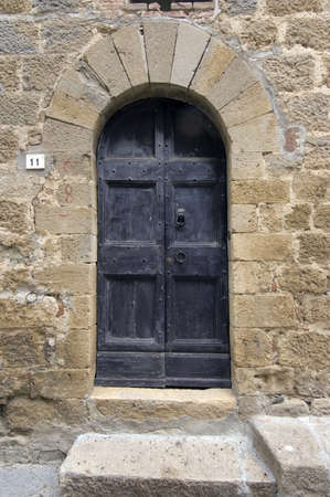 Old wooden door. Number 11. Italian style. Tuscany Stock Photo - 4142500