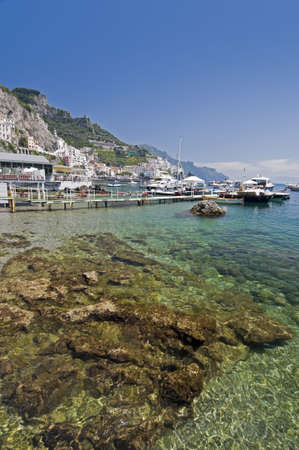 Amalfi Coast, transparent water in the harbor with boat. Naples - Best of Italy photo