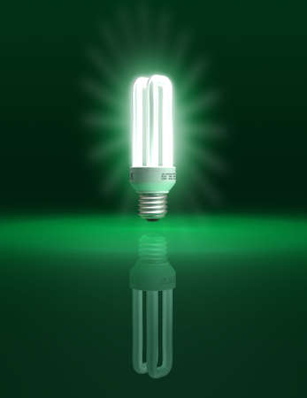 compact: Eco friendly light bulb on green background - conceptual illustration - clipping path included