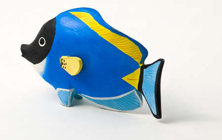 Surgeon fish stained wood - toy - souvenirs of tropical seas. photo