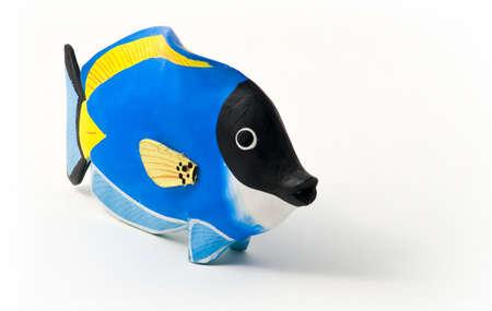 surgeon fish: Pez cirujano hab�a te�ido de madera, juguetes, recuerdos de los mares tropicales.