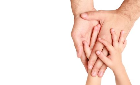 hands of the child in the hands of an adult male