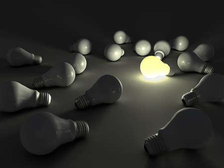 lit light bulb among unlit ones photo