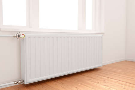 and heating: central heating radiator conceptual of increasing costs of energy