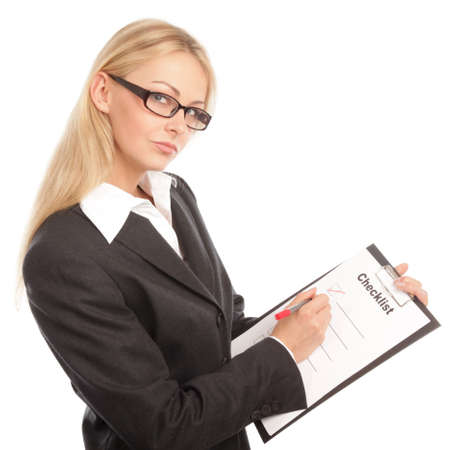 clipboards: Business woman with a checklist thinking Stock Photo