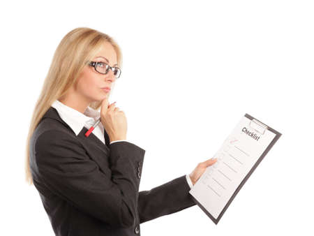 clipboard isolated: Business woman with a checklist thinking Stock Photo