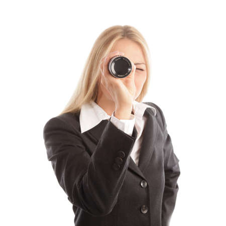 looking into camera: Donna d'affari bionda con cannocchiale guardando la telecamera