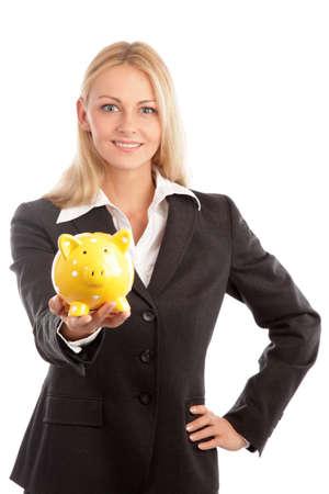 金發碧眼的女人和一個黃色儲蓄罐 版權商用圖片