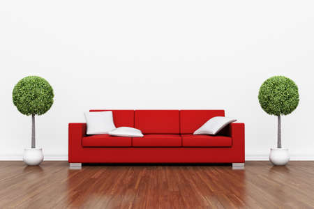 copy room: Red couch on wooden floor with white cushions Stock Photo