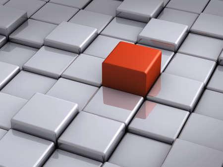 Cubo rojo pendiente en primer plano los bloques de cromo Foto de archivo